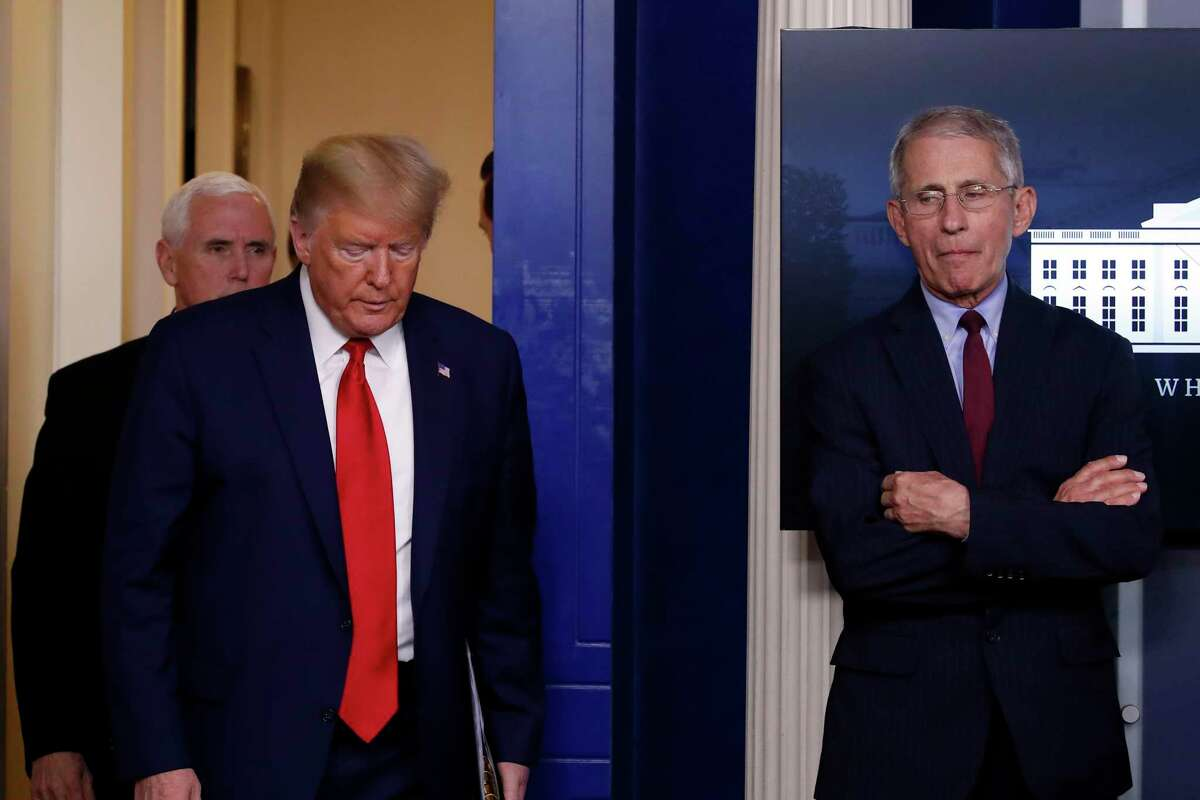 President Donald Trump arrives to Vice President Mike Pence to speak about the coronavirus in the James Brady Press Briefing Room of the White House, Tuesday, March 31, 2020, in Washington. At right is Dr. Anthony Fauci, director of the National Institute of Allergy and Infectious Diseases. (AP Photo/Alex Brandon)
