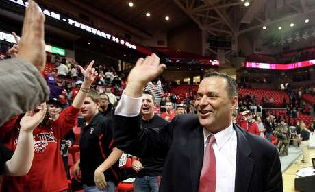 In this Feb. 11, 2012, file photo, Texas Tech coach Billy Gillispie celebrates with fans after defeating Oklahoma in an NCAA college basketball game in Lubbock, Texas. Gillispie was named head coach at Tarleton State, taking over a program making the transition from NCAA Division II to Division I. The move Monday, March 30, 3030, came two years after Gillispie had a successful kidney transplant, and eight years after his last Division I job.