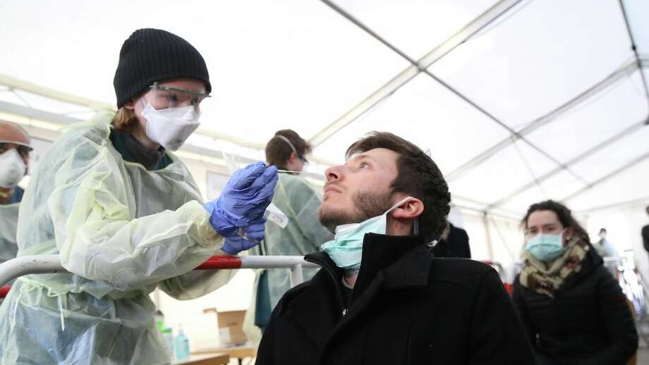 Testing for coronavirus in Germany, medical personnel take samples from the nose. Photo: Alexander Hassenstein/Getty