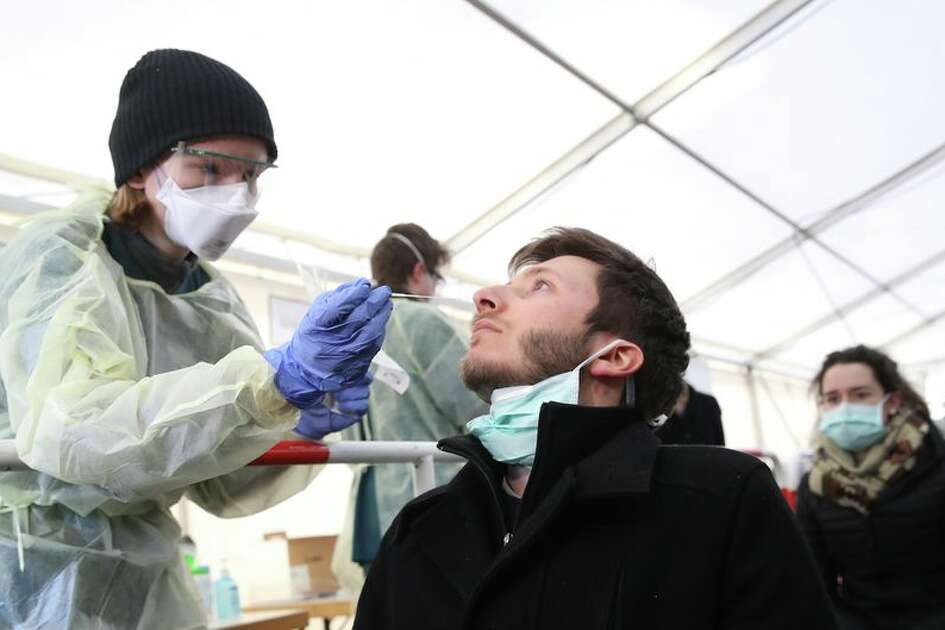 Testing for coronavirus in Germany, medical personnel take samples from the nose.