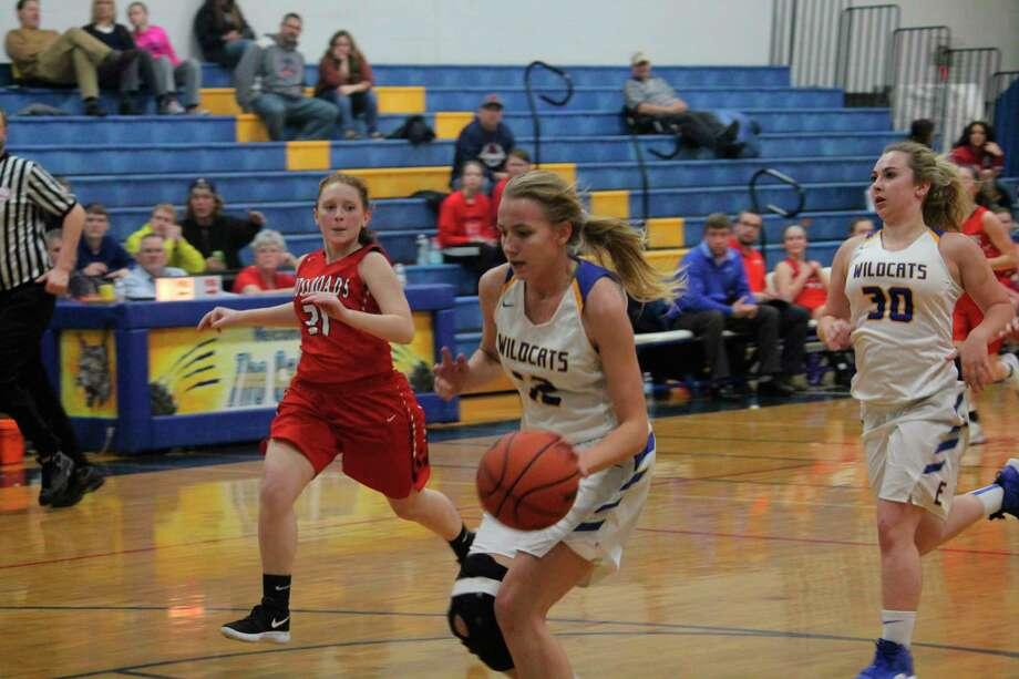 Kara Henry (with ball) was among Evart's top basketball players this season. (Herald-Review file photo)