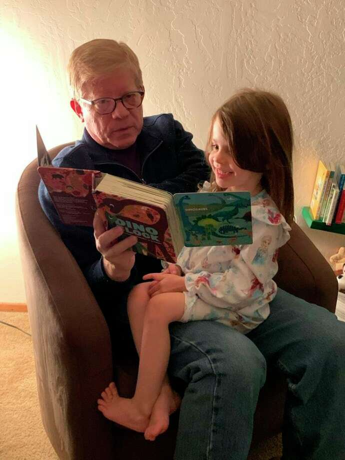 A local child enjoys her new book from Dolly Parton's Imagination Library. (Submitted photo)