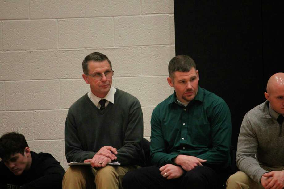 Pine River coach Tim Jones (left) and assistant Terry Martin watch a match during the regular season. (Herald Review photo/John Raffel)