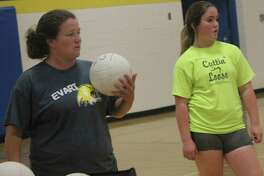Evart softball coach Amanda Brown (left) is pictured here working with the volleyball team last summer. (Herald Review file photo)