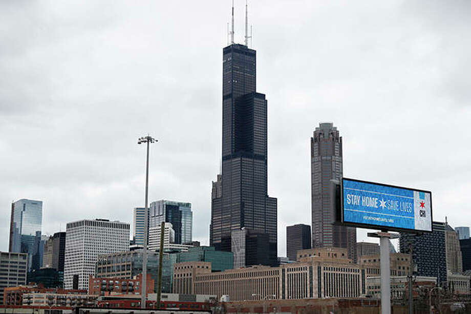 """The message """"Stay Home Saves Lives"""" is seen against the Chicago skyline. Photo: Charles Rex Arbogast 