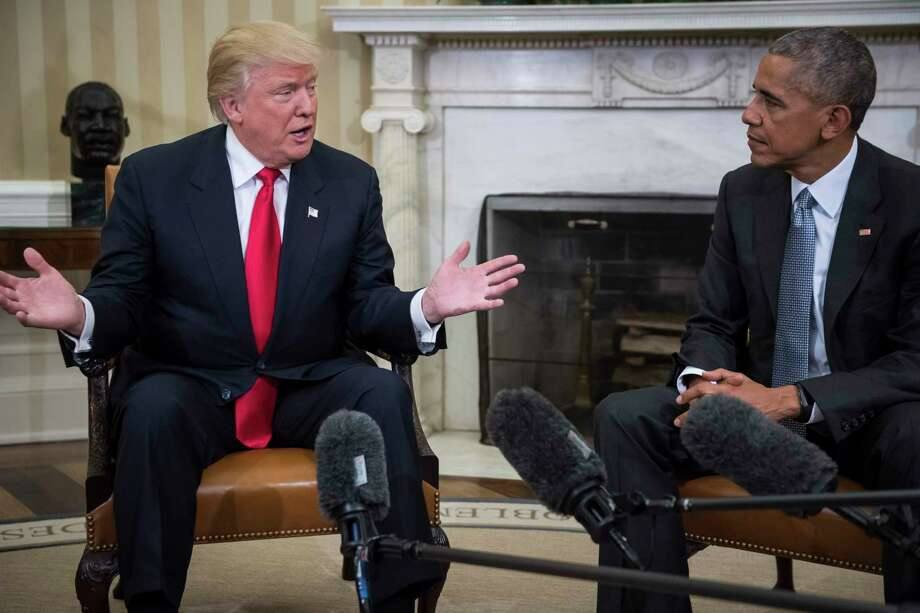 President Barack Obama and president-elect Donald Trump talk to members of the media during a meeting in the Oval Office of the White House on Nov. 10, 2016. Photo: Washington Post Photo By Jabin Botsford. / The Washington Post