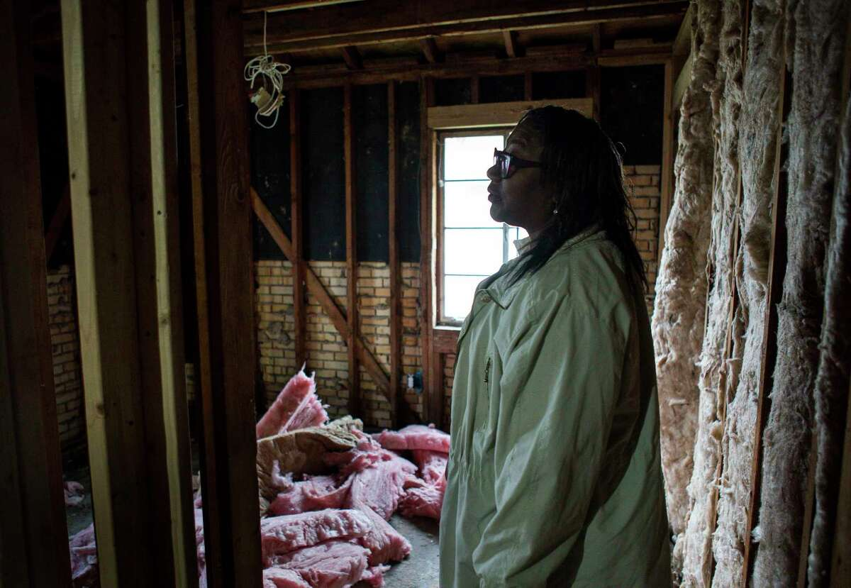 Alberta Fleming walks through her Harvey-damaged home, Monday, Feb. 4, 2019 in Houston. Fleming has been living in her car since last summer because the house is still completely gutted inside and smells of mold. She used to raise her grandchildren inside the house, but since the storm Fleming has been alone trying to find help fixing the house that she owns. Feet of water inundated the house when Harvey flooded Houston in August of 2017.