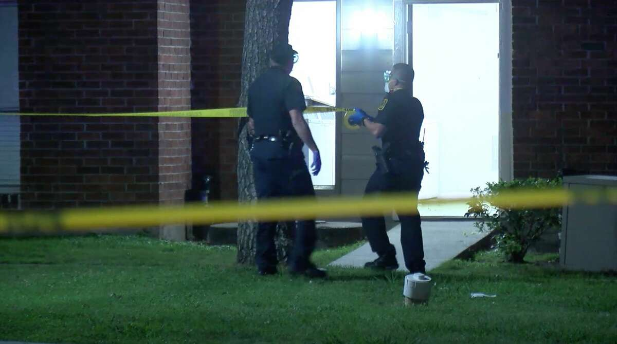 Houston police officers investigate the shooting of a 5-year-old boy in the 8100 block of Richmond on Monday, March 31, 2020.