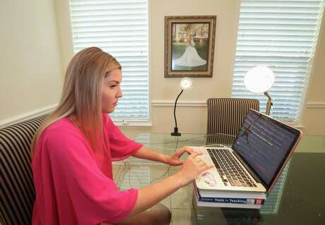 Kathryn Ashy films herself Tuesday, March 31, 2020, to apply for a teaching position with Clear Creek ISD. The district hosted a virtual hiring fair on its website and asked applicants to include a two-minute video of themselves.