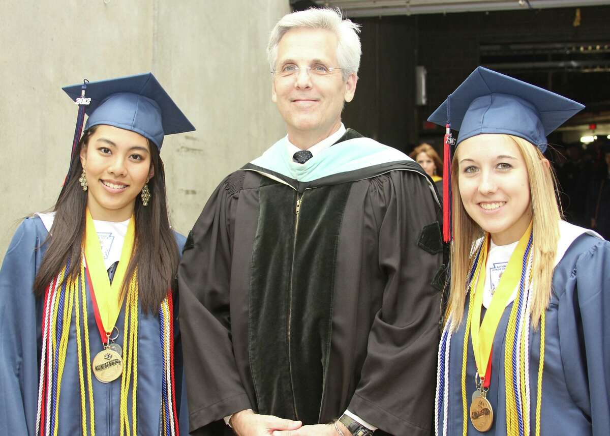 Pearland ISD Superintendent John Kelly, shown with Dawson High School graduates at a previous year's graduation ceremony, has alerted the community that the novel coronavirus pandemic theatens chances for such ceremonies this year.
