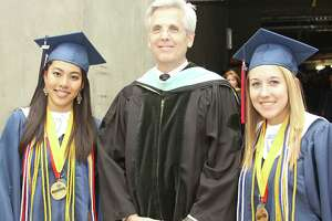 """Pearland ISD Superintendent John Kelly, shown with Dawson High School graduates at a previous year's graduation ceremony, has alerted the community that the novel coronavirus pandemic theatens chances for such ceremonies this year. """"While our hundreds of senior students will complete high school requirements and (be) pronounced as graduates,"""" he said. """"It remains very uncertain whether an accompanying ceremony can or will occur."""""""