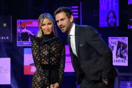 Nick Viall and Kaitlyn Bristowe onstage during the 2020 iHeartRadio Podcast Awards.
