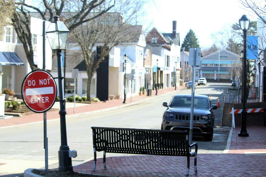 Main Street in Westport with several businesses closed and restaurants doing take-out to slow the spread of the coronavirus. Photo: DJ Simmons / Hearst Connecticut Media