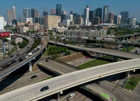 Traffic on the southwest side downtown, during the first day of a stay-at-home order put in place by county and city officials Wednesday, March 25, 2020, in Houston. The measure was implemented in hopes of stopping the spread of COVID-19.