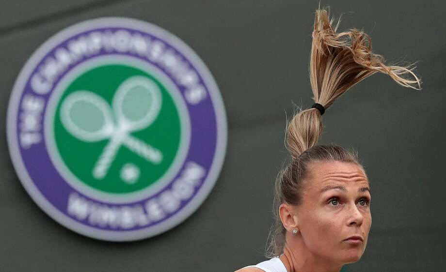 TOPSHOT - Slovakia's Magdalena Rybarikova serves against US player Coco Vandeweghe during their women's singles quarter-final match on the eighth day of the 2017 Wimbledon Championships at The All England Lawn Tennis Club in Wimbledon, southwest London, on July 11, 2017. (DANIEL LEAL-OLIVAS/AFP via Getty Images) Photo: AFP Contributor/AFP Via Getty Images