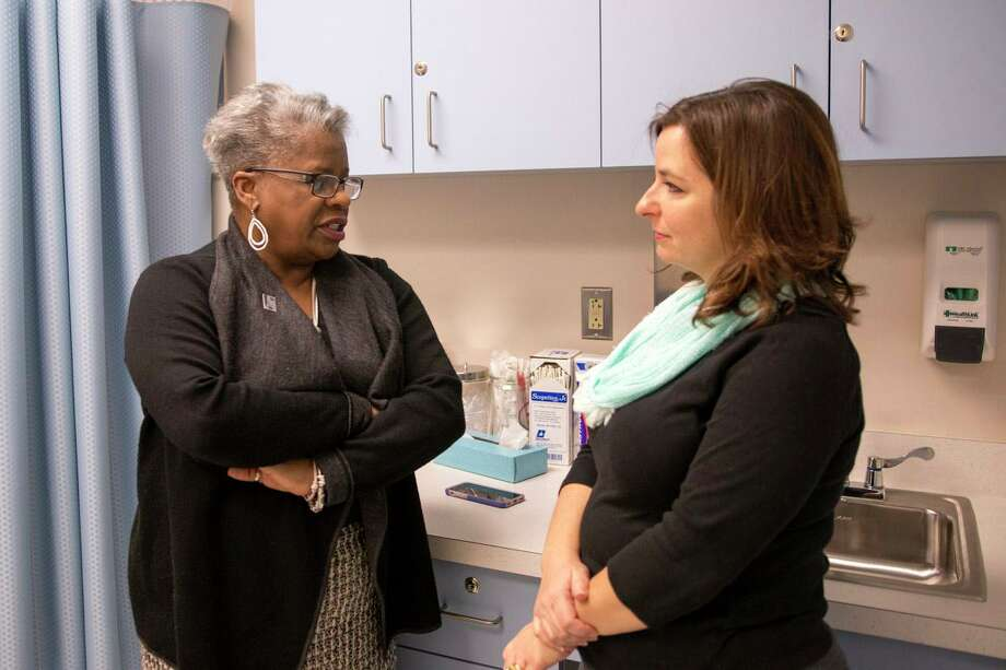 Deb Polun, right, executive director of the Connecticut Association for Community Action, with state Sen. Marilyn Moore in 2015. Photo: Contributed Photo / Connecticut Post Contributed