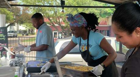 Jarrett Milton (from left),Perla Chavez and Misteri Sanders prepares vegan barbecue at the Houston Sauce Pit. The food truckopened in January 2020 and is still busy at its new location at4819 Almeda Road, Houston, despite the novel coronavirus outbreak.