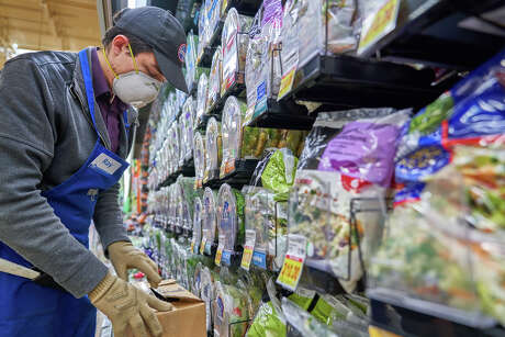 Kroger photos show measures the grocer has taken to protect employees from coronavirus.