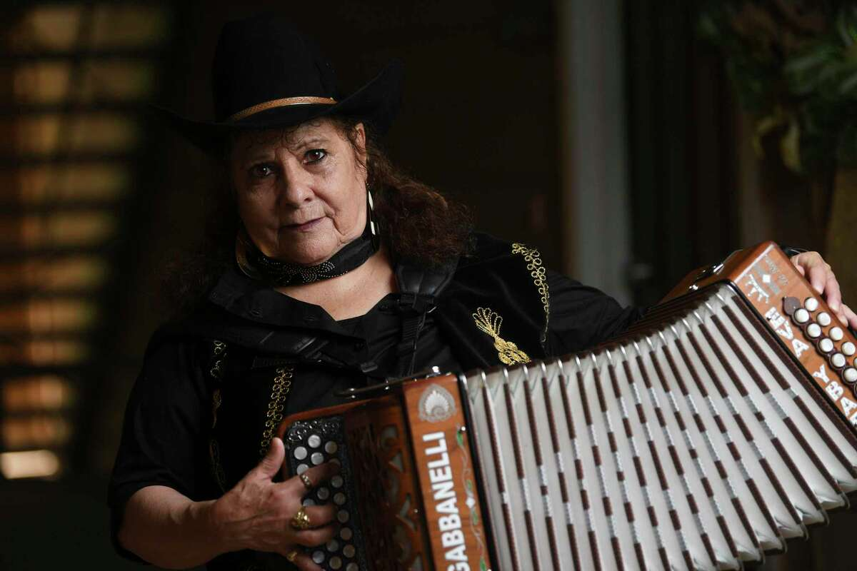Eva Ybarra, often called the queen of the accordion, makes much of her income from restaurant gigs. She says she's worried about how she's going to pay her rent now.