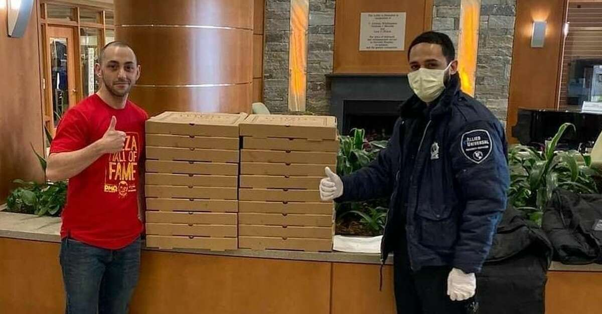 Matt Nuzio of Letizia's delivers pizzas to Norwalk Hospital, courtesy of students and families of Our Lady of Fatima Catholic Academy in Wilton, Conn. March 2020