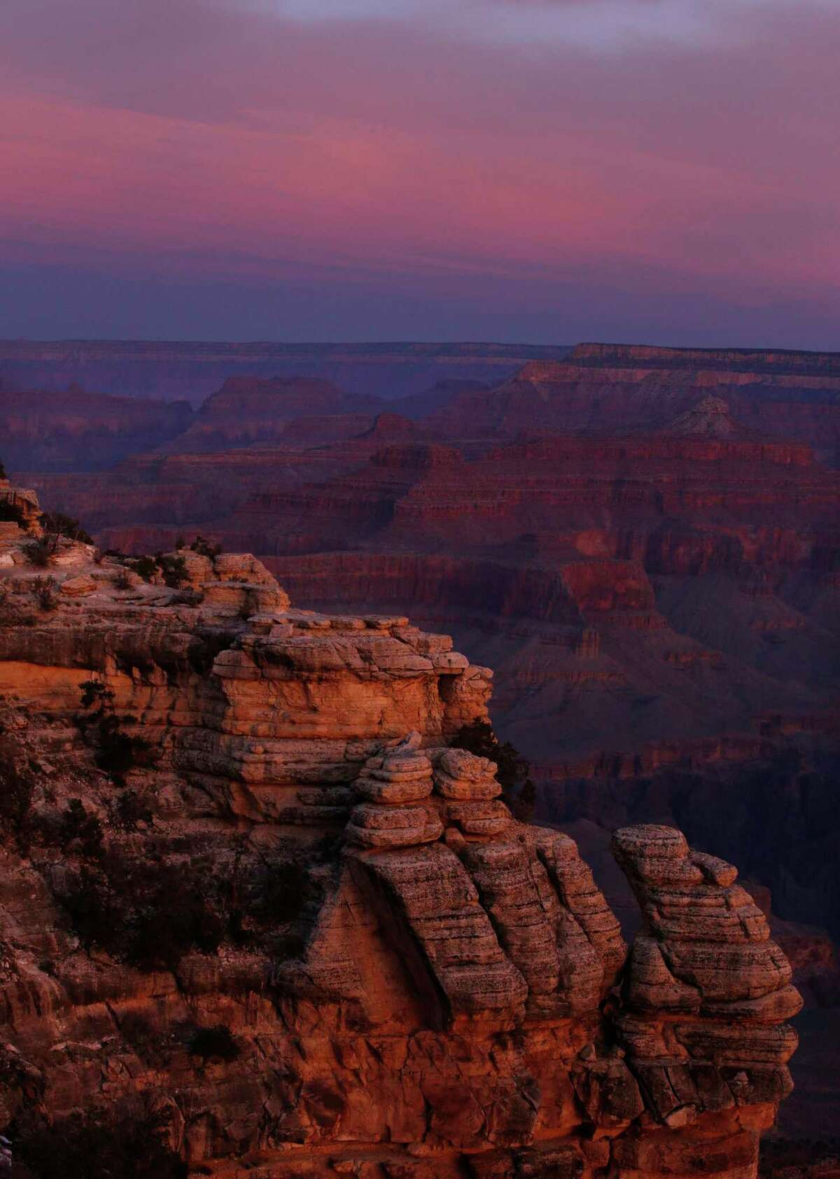 The colors of dawn begin to paint the age-old rock formations of the Grand Canyon along the South Rim near Mather Point on March 11, 2015. Many national parks are so far remaining open during the coronavirus pandemic. (Mark Boster/Los Angeles Times/TNS)