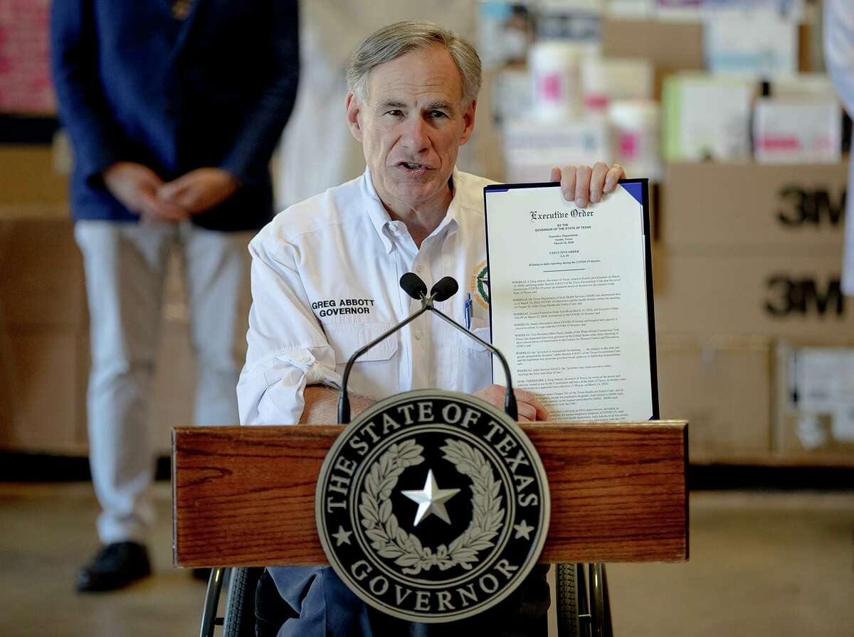 Texas Gov. Greg Abbott, seen here last month, outlines a new executive order about the reporting of COVID-19 data. On Tuesday, Abbott announced the temporary closure of state parks and historic sites.