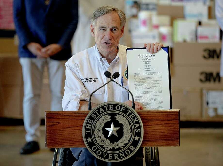 Texas Gov. Greg Abbott, seen here last month, outlines a new executive order about the reporting of COVID-19 data. On Tuesday, Abbott announced the temporary closure of state parks and historic sites. Photo: Nick Wagner /Associated Press / Austin American-Statesman