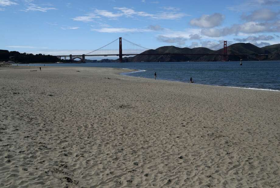 The beach at Crissy Field is nearly empty on Monday, March 30, 2020 in San Francisco, Calif. Officials in seven San Francisco Bay Area counties have announced plans to extend the shelter in place order until May 1. Photo: Justin Sullivan/TNS