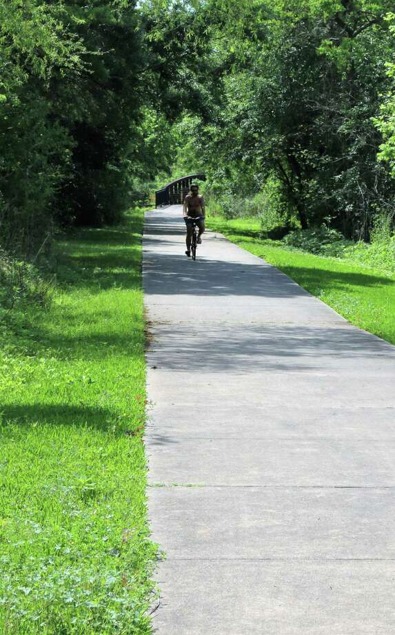 A cyclist makes his way along a trail in Little Cedar Bayou Park that is part of a hike-and-bike network in the city of La Porte. The park is the highlight of the city's hike-and-bike system's destinations. Photo: John DeLapp / Correspondent