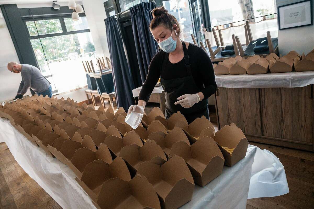 Chef and owner of Nightbird restaurant Kim Alter prepares meals at her restaurant in San Francisco, Calif. on Monday March 30, 2020. The meals will be delivered to low income housing units and SRO�s the following day.