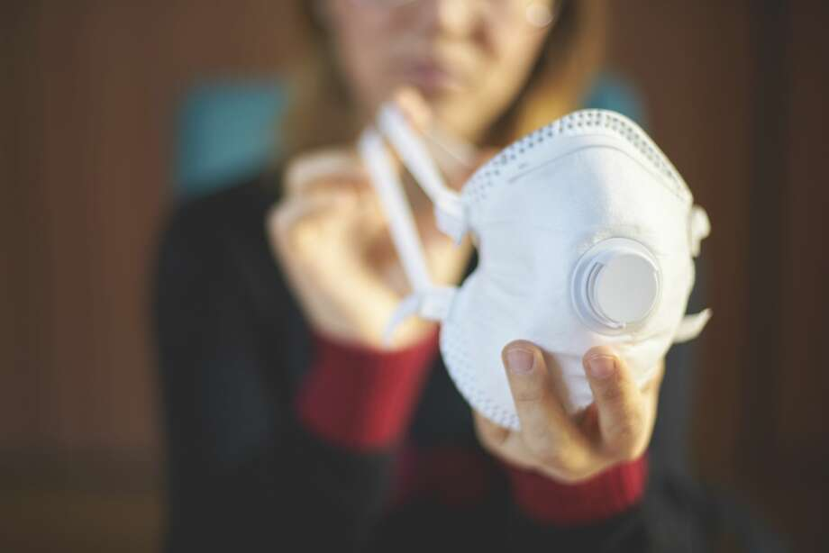 A properly fitted respirator mask, like an N95 mask, provides more protection against exposure to infection than a surgical mask or a home-made mask. There are still not N95 masks available for U.S. health workers. Photo: Nico De Pasquale/Getty Images / Nico De Pasquale
