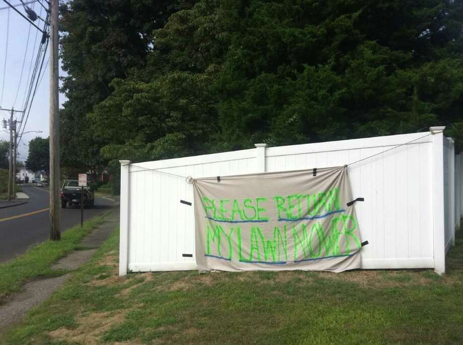 This sign was posted at Longview Avenue and Kings Highway East by Lisa Havey after someone swiped her lawn mower last weekend. Photo: Gary Jeanfaivre / Fairfield Citizen