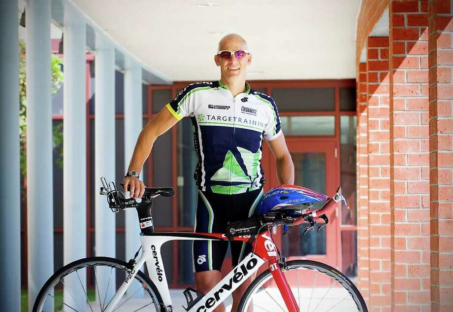 Mitch West, 40, is a social worker at Westover Magnet Elementary School Stamford,  Conn. on Thursday August 19,  2010.. He competes in Iron Man races, and rides his bicycle to school every day from his home in Wilton. Photo: Kathleen O'Rourke / Stamford Advocate