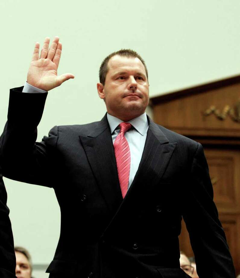 This Feb. 13, 2008 file photo shows former New York Yankees baseball pitcher Roger Clemens being sworn-in on Capitol Hill in Washington, prior to testifying before the House Oversight, and Government Reform committee hearing on drug use in baseball. (AP Photo/Susan Walsh, File) Photo: Susan Walsh / AP