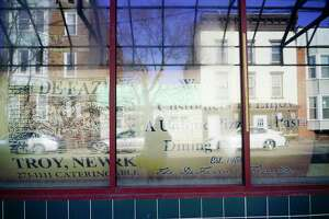 A sign seen in the window of a building on 4th Street in the Little Italy neighborhood section on Wednesday, April 1, 2020, in Troy, N.Y. DeFazio's, which has a pizza shop south of this location on 4th Street, hopes to start construction at this location on a planned restaurant.   (Paul Buckowski/Times Union)