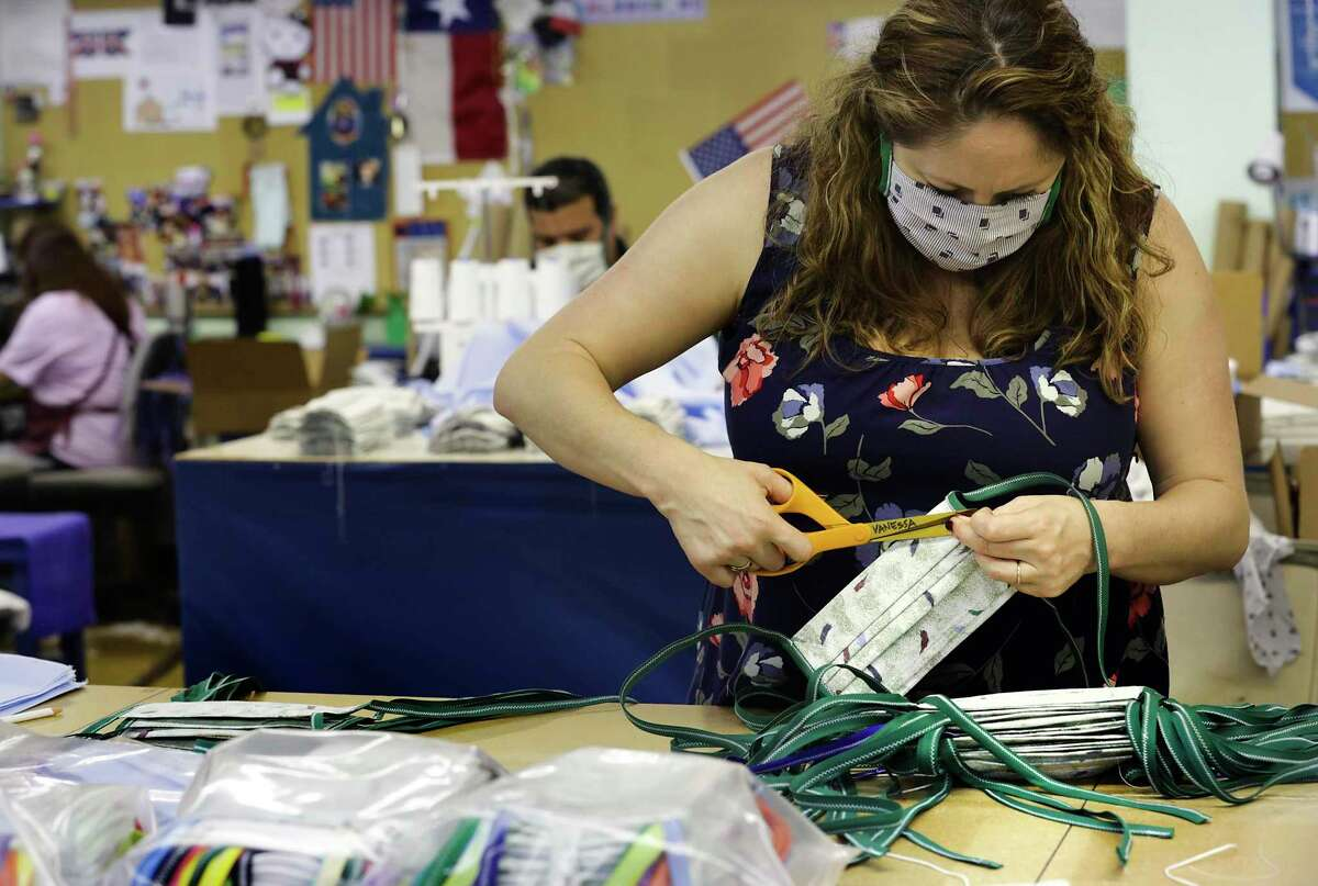 Vanessa Van de Putte, president of Dixie Flag & Banner Co., inspects masks. The company has switched some of its production work to face masks in response to COVID-19 - an example of Texas businesses responding to this crisis and saving lives.