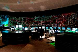 NYISO workers spend 12-hour shifts in the control room which oversees New York's energy grid.