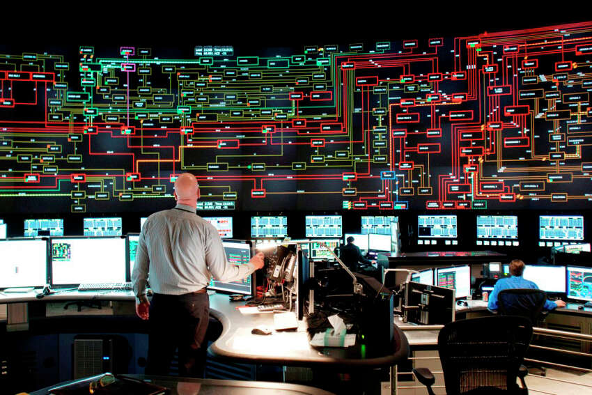 The NYISO control room is windowless and darkened to better display the depiction of the state's power grid.