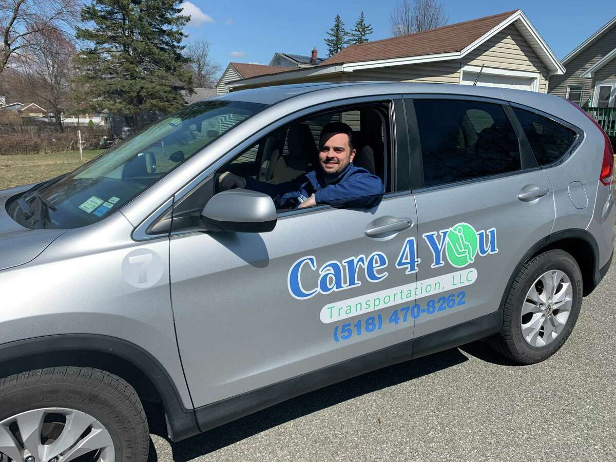 Richard Castiglia Jr., supervisor for Care 4 You Transportation, in one of the business' vehicles.