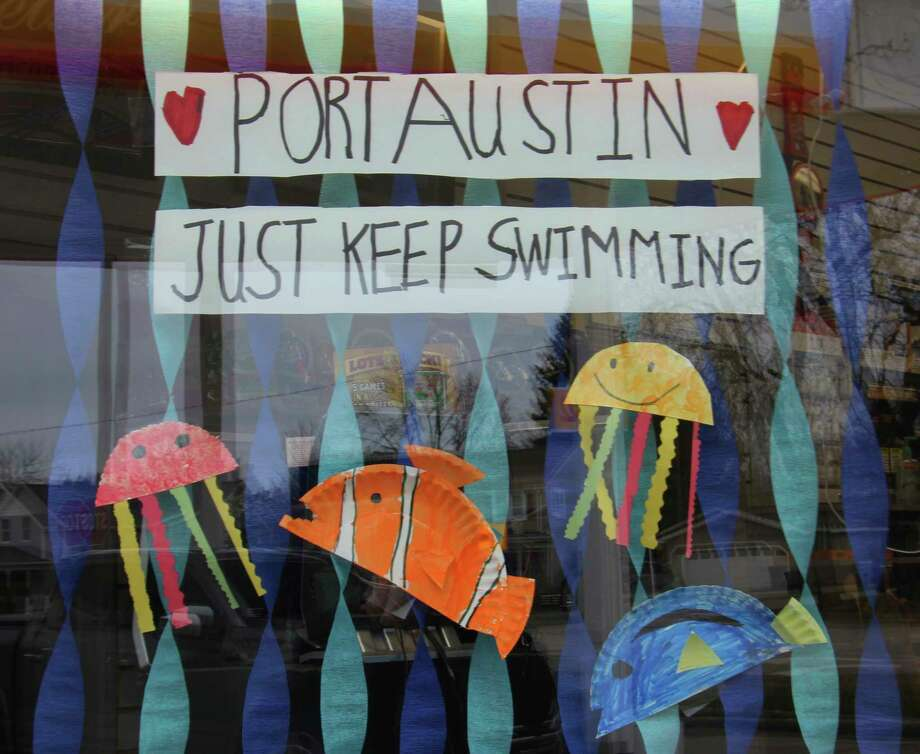 "Decorations inspired by the movies ""Finding Nemo"" and ""Finding Dory"" hang in a window in Port Austin reminding area residents to ""just keep swimming"" during this difficult time. (Sara Eisinger/Huron Daily Tribune)"