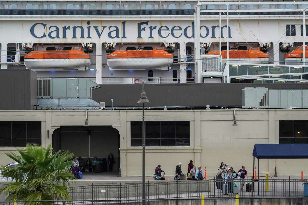 Passengers of Carnival Cruise Line walk out of Port of Galveston Cruise Terminal on Sunday March 8, 2020 in Galveston, Texas.