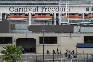 Passengers of Carnival Cruise Line walk out of Port of Galveston Cruise Terminal on Sunday March 8, 2020 in Galveston, Texas.The cruise ship was rerouted over worries it wouldn't be able to dock in some Caribbean ports because many destinations are tightening entry policies amid growing global concern over the COVID-19 outbreak.