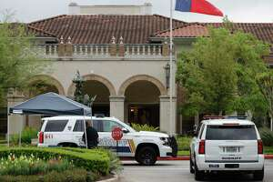 Officers with Montgomery County Sheriff's Office provide added security and screening at The Conservatory at Alden Bridge after 12 residents tested positive for coronavirus, Tuesday, March 31, 2020, in The Woodlands. On Monday, Montgomery County Judge Mark Keough issued a shelter-in-place order for residents of the senior living community that offers apartment homes for up to 237 residents.