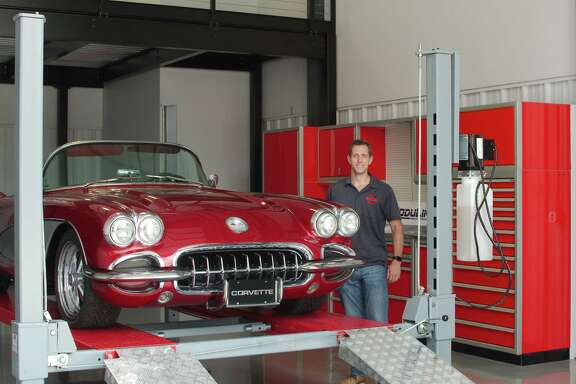 Garage Ultimate owner Nick Deutsch stands with his 1960 Corvette in one of the garages for sale at his Friendswood complex.