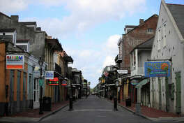 A view of empty Bourbon street in the French Quarter amid the coronavirus (COVID-19) pandemic on March 27, 2020 in New Orleans, Louisiana.