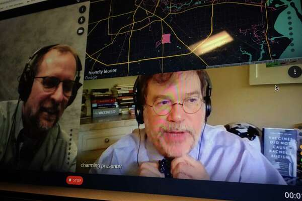 Infectious disease expert Peter Hotez, beginning the day's first coronavirus interview from his home office, ties his famous bowtie.