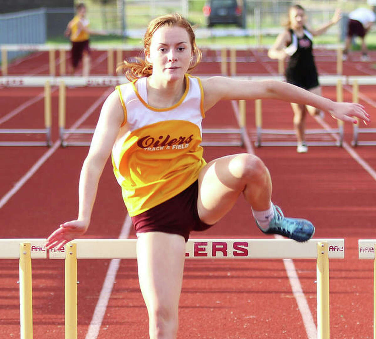 EA-WR's LeighAnn Nottke clears the final hurdle on her way to a victory in the 300-meter hurdles at the Prairie State Conference meet last season in Wood River. Nottke, a senior, and other spring sports athletes retain hope for their season to begin sometime in May.