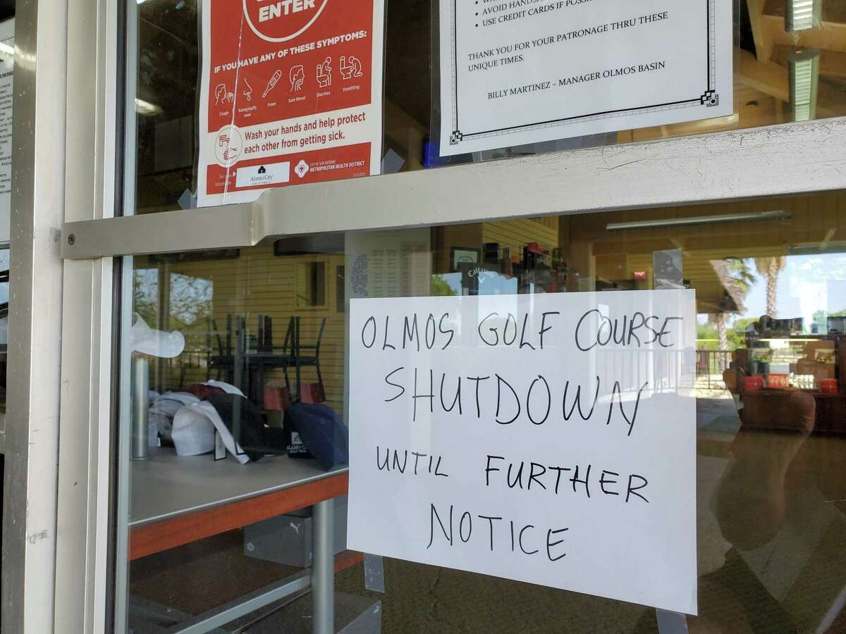 A sign at the clubhouse of Olmos Basin Golf Course, which is closed pending results of a COVID-19 test of an ill employee who cleans golf carts there.