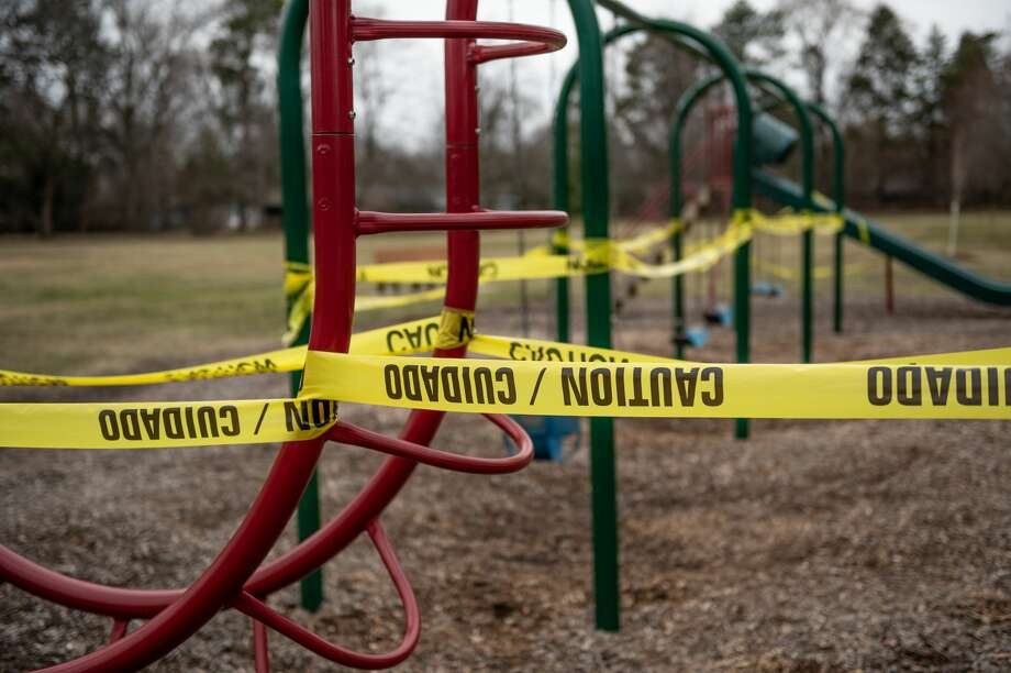 Parks in Midland are shown devoid of activity after City of Midland Parks and Recreation closed the playground equipment in all City of Midland-maintained parks effective Monday, March 30, 2020 until further notice, out of an abundance of caution amid the ongoing COVID-19 pandemic. (Adam Ferman/for the Daily News) Photo: (Adam Ferman/for The Daily News)
