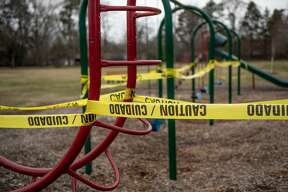 Parks in Midland are shown devoid of activity after City of Midland Parks and Recreation closed the playground equipment in all City of Midland-maintained parks effective Monday, March 30, 2020 until further notice, out of an abundance of caution amid the ongoing COVID-19 pandemic. (Adam Ferman/for the Daily News)